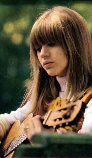 Marianne Faithfull playing the guitar