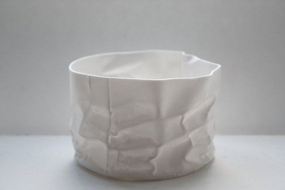 Crumpled paper looking white vessel made out of English fine bone china by madebymanos