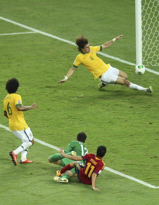 Brazil's David Luiz deflects a ball by Spain's Pedro Rodriguez