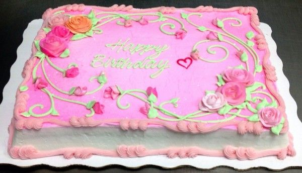 Pink rose sheet cake decorated by Leslie Schoenecker at Wal-Mart