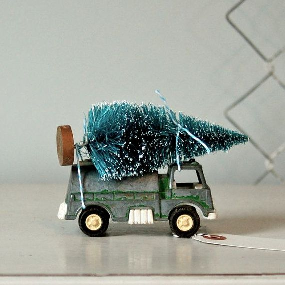 little toy truck with bottle brush tree.