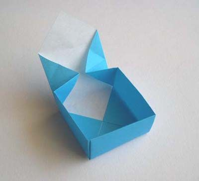 Origami box - make two, one slightly larger, to have a box + lid. Can make with leftover wrapping paper. Fill with homemade sweets/cookies, and tie with pretty twine to gift.