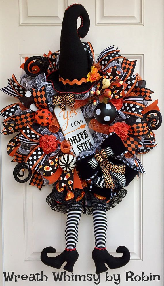 Fancy Deco Mesh Halloween Witch Wreath in Orange & Black. This pretty witch will be sure to delight visitors this fall! This wreath is constructed with a black/white striped deco mesh which is then layered with orange foil deco mesh rolls. The beautiful witch consists of 2 hand sewn pieces of the finest quality. The witch legs are accented with a frilly pumpkin patterned skirt. The hat is embellished with trim and silk floral. Surrounding the wreath are 28 ribbon streamers and a la...