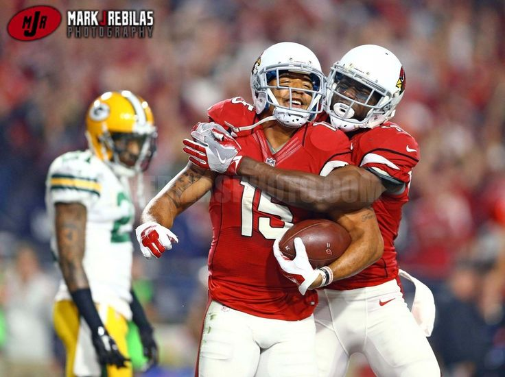Canon 1Dx, 400mm, 3200iso, f2.8, 1/1600th, Manual Arizona Cardinals wide receiver Michael Floyd (left) celebrates a touchdown catch with Jaron Brown against the Green Bay Packers during an NFC Divisional round playoff game at University of Phoenix Stadium. Mandatory Credit: Mark J. Rebilas-USA TODAY Sports