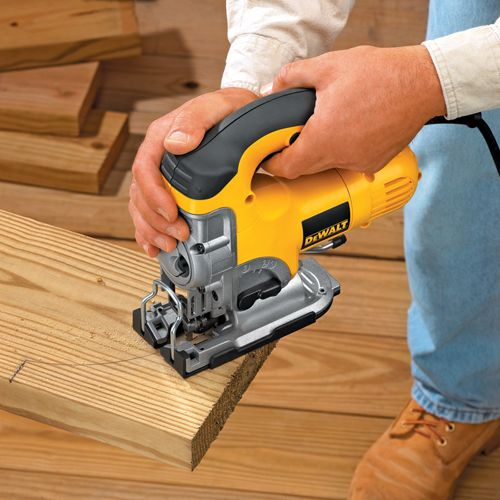 The DEWALT Variable Speed Top-Handle Jigsaw Kit provides you with the power, precision, and innovative features you need for detailed work and curved cuts. To make fast, accurate work of tough jobs, this jigsaw kit features variable speed control in the dial and trigger, positive bevel detents on the shoe at commonly used angles, and integrated dust management.