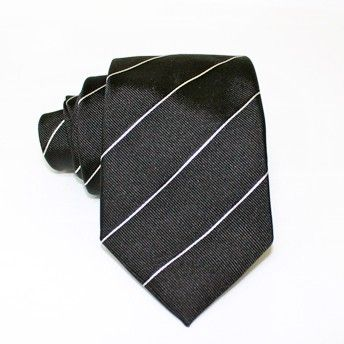 Jacquard tie, 100% silk, dark grey with oblique white stripes. Ideal for less formal occasions but also special occasions. Pattern and color of this elegant tie can fit with any outfit.