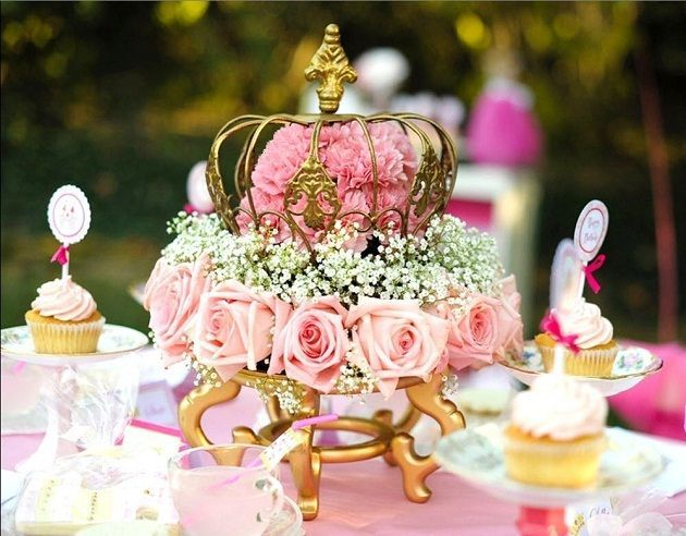 Pink Princess Tea Party Centerpiece ~ floral foam soaked in water and placed on a small stand.  Pink roses, carnation, and baby's breath were inserted and a gold decorative crown topped it all off. Beautiful party, check out all the photos and ideas!