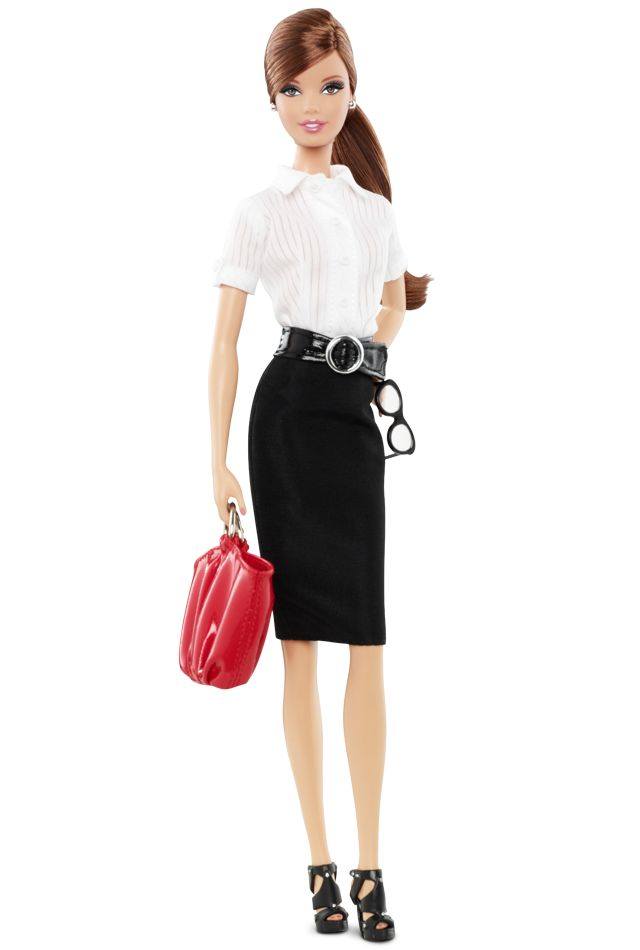 in addition the fact that this doll and I share the same shade of auburn hair, I am thrilled to discover that she comes complete with miniature accessories: Tim Gunn bible and smartphone included. Barbie® Styled By Tim Gunn -  Doll 2 via Barbie Collector