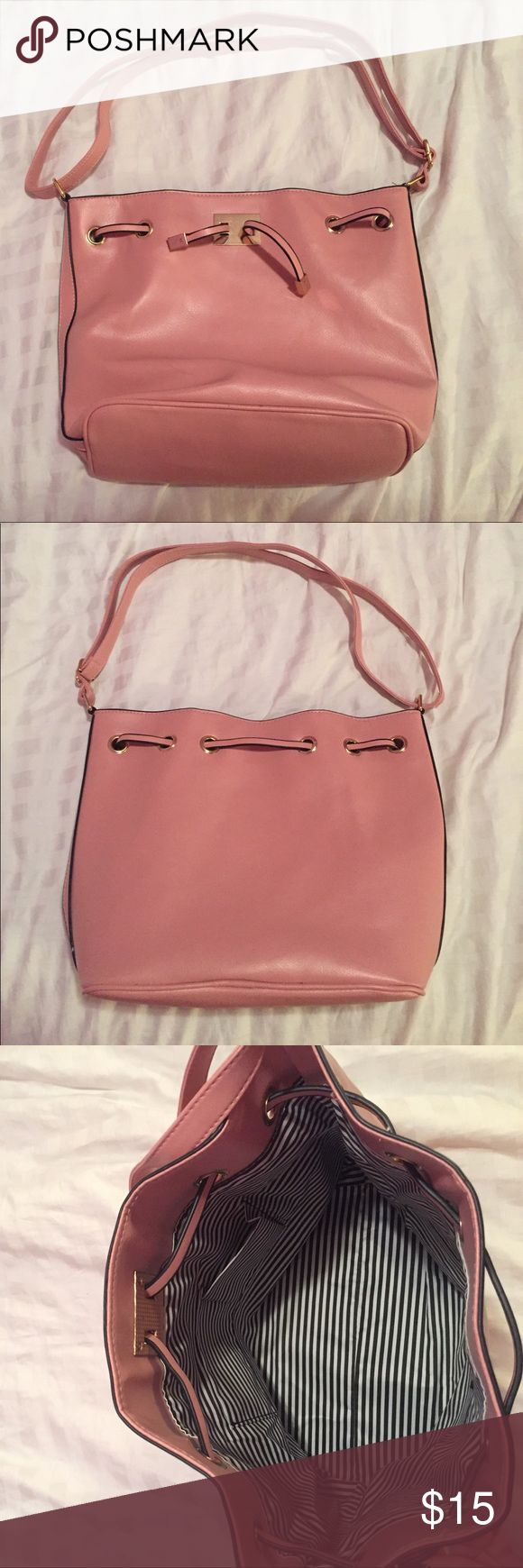 Baby Pink Purse/Tote material feels like leather (it is not) and it has a large inside so lots of room for storage. it is a med-large size bag. never used, great condition. From TJ Maxx. Bags Totes