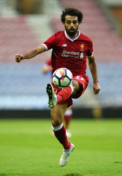 Mohamed Salah Photos Photos - Mohamed Salah of Liverpool controls the ball during the pre-season friendly match between Wigan Athletic and Liverpool at DW Stadium on July 14, 2017 in Wigan, England. - Wigan Athletic v Liverpool - Pre Season Friendly