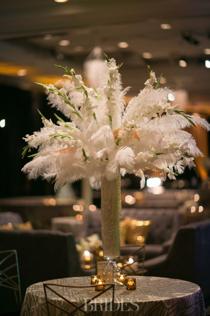 Nicole and Michael Phelps Had a New Year's Eve Wedding That Was Totally Epic -Feather and Pearl Centerpieces Event Design by Victoria Canada Weddings and Events, Floral: AZ Petal Pushers, Location: Arizona Biltmore, Image: Boone Studios, Chairs: Chameleon Chairs, Lighting: Karma Event Lighting and PSAV www.weddingsandevents.net @vcweddingsandevents