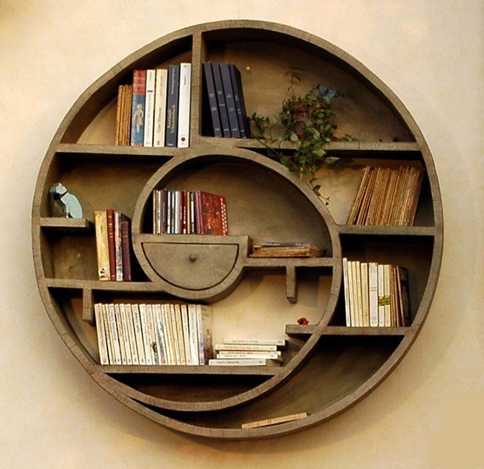 Swirly wooden shelf, reminds me of a snail - the little drawer in the middle is fantastic touch!