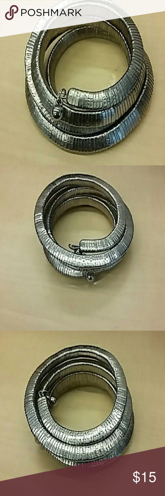 "Silver mesh ""snake"" bracelet Heavy silver mesh bracelet wraps around arm like a snake. Small silver balls on each tip Jewelry Bracelets"