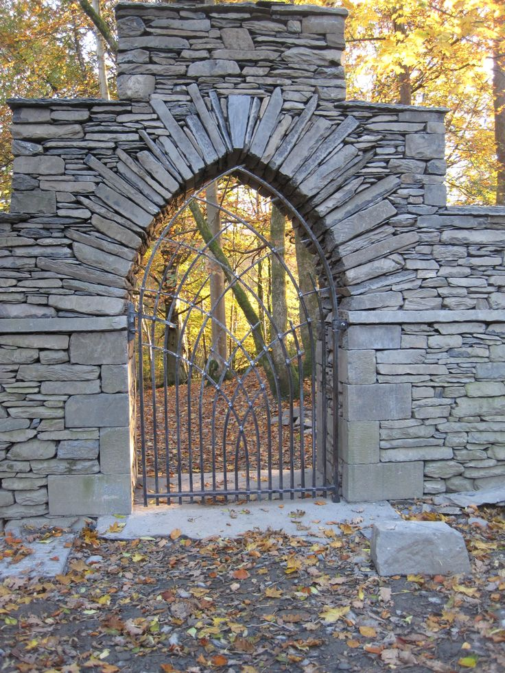 """""""Gothic arch in slate with wrought iron gate, built by Andrew Loudon."""""""