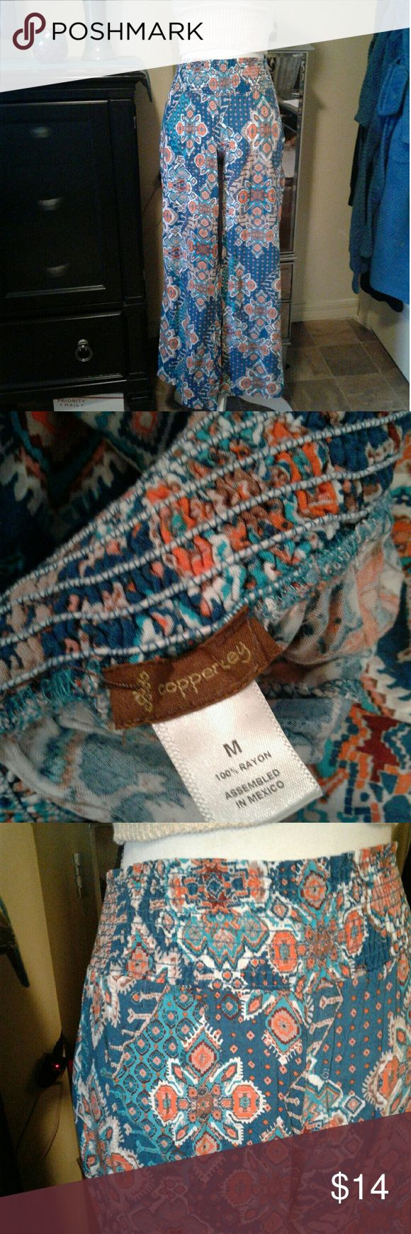 """Copper Key high waisted wide leg pant Women's very gently pre loved blue/Orange tribal Copper Key elastic high waisted wide leg flowy pants size Medium. Measurements waist 11"""" length 37"""". Thanks for looking Bundle to save!! Copper Key Pants Wide Leg"""