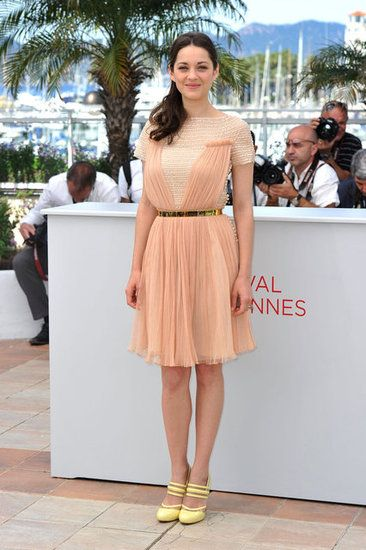 Marion Cotillard in Christian Dior and sunny Versus heels at Cannes.