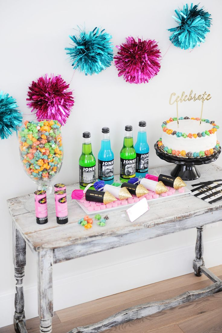Pop Clink Fizz New Year's Eve Party This fun and easy party theme gets a twist for a family friendly New Year's Eve party with Popcorn and Soda providing the Pop and Fizz.  Make it colorful with all kinds of fun party supplies from the HomeGoods stationery and party aisle.  Sponsored Pin. #newyearseve #partyideas