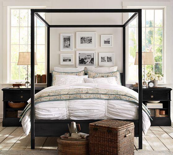 love this bedroom set up - bed between windows, pictures over headboard.