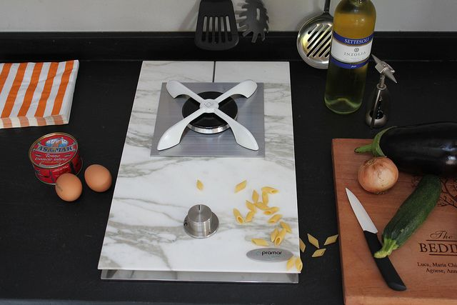 Domino hob in Calacatta marble by PramarStone, the first company in the world to realize an hob in natural materials. www.pramarstone.com
