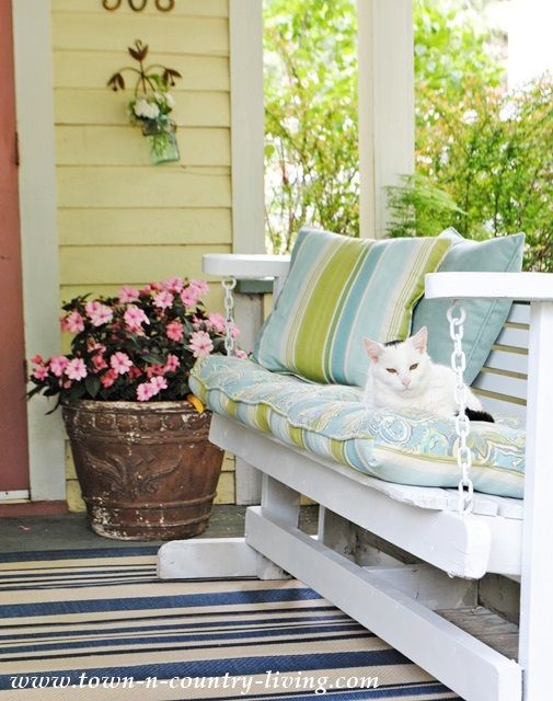 how i turned my farmhouse porch into a mini retreat - Porch Gliders