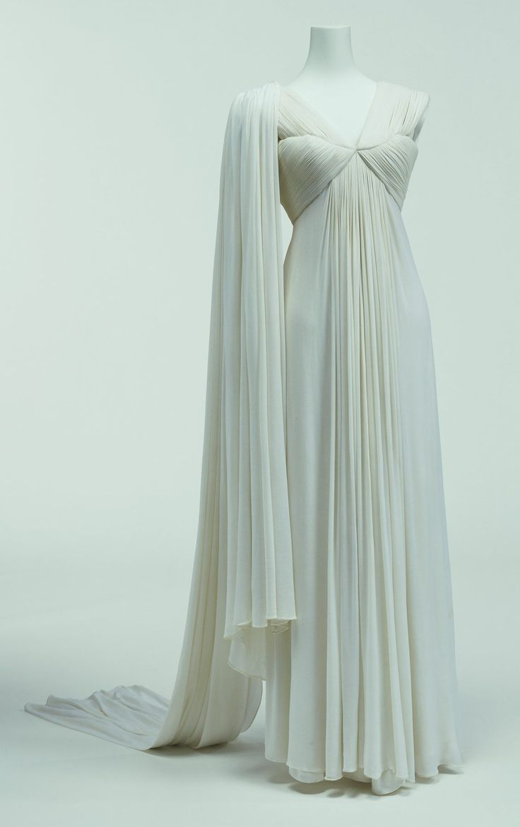 "Evening Dress, Madame Grès: ca. 1944, one-piece cut of silk jersey finely pleated. ""...Madame Grès opened the fashion house Alix in 1934, but was forces to close it in 1939. In 1942 she opened a new house under her husband's ""nom d'artiste"", Grès. In the mid-1930s she became known for extravagantly arranged clothes made of silk jersey in the classical Greek style and with few visible seams..."""