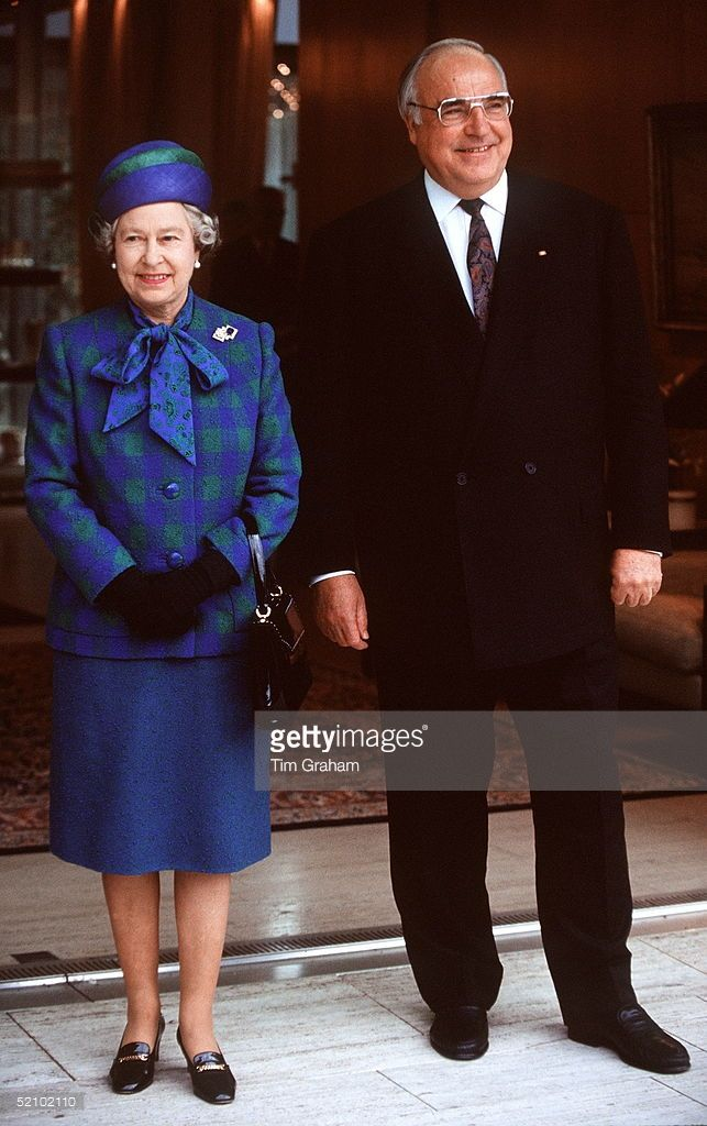 The Queen With Chancellor Helmut Kohl In Bonn, Germany. She Is Wearing An Outfit…