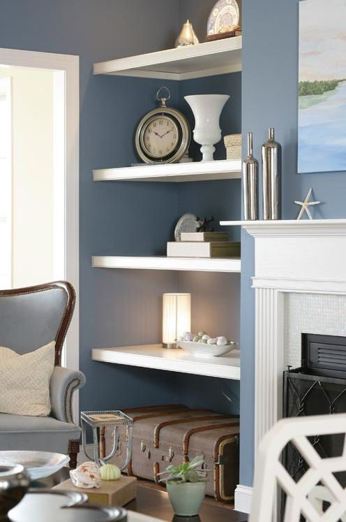 like the white shelves against the blue grey walls and white
