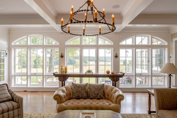Heritage House with addition antique wood floor arched windows beam ceiling candle chandelier candle sconce country house farmhouse oak floor okie pennsylva