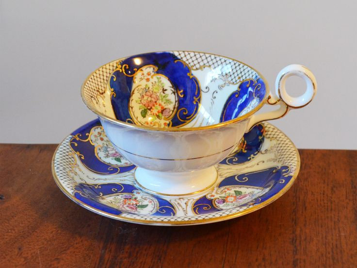 Regent Fenton Blue Cobalt Teacup and saucer bone china - circa 1930s, unique circle handle, hand-numbered and hand-painted by Trashtiques on Etsy https://www.etsy.com/ca/listing/511653342/regent-fenton-blue-cobalt-teacup-and