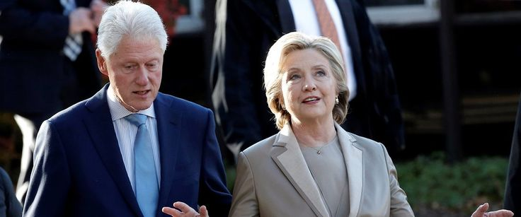 Democratic U.S. presidential nominee Hillary Clinton and her husband former U.S. president Bill Clinton depart after voting in the U.S. presidential election at the Grafflin Elementary School in Chappaqua, New York, U.S., November 8, 2016. REUTERS/Mike Segar.