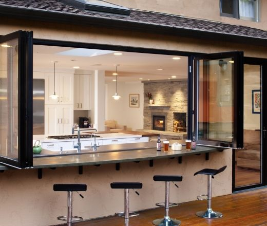 this is amazing- what a great way to combine outdoor entertaining with all the conveniences of the kitchen! Contemporary U-shaped Orange kitchen, white cabinets, Denver
