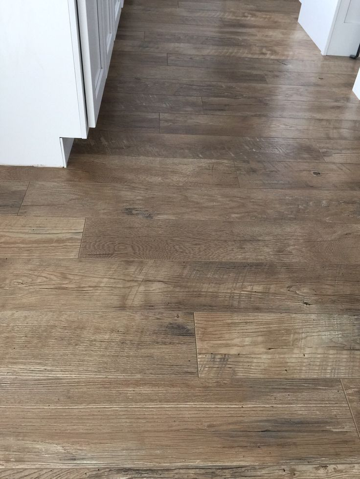Why I chose laminate flooring and how I will never regret this decision! High end laminate with texture And I think it holds up to moisture pretty well.  It's called Historic Oak in Ash through the company Mannington.  Mannington has a ton of high end laminates that are gorgeous.