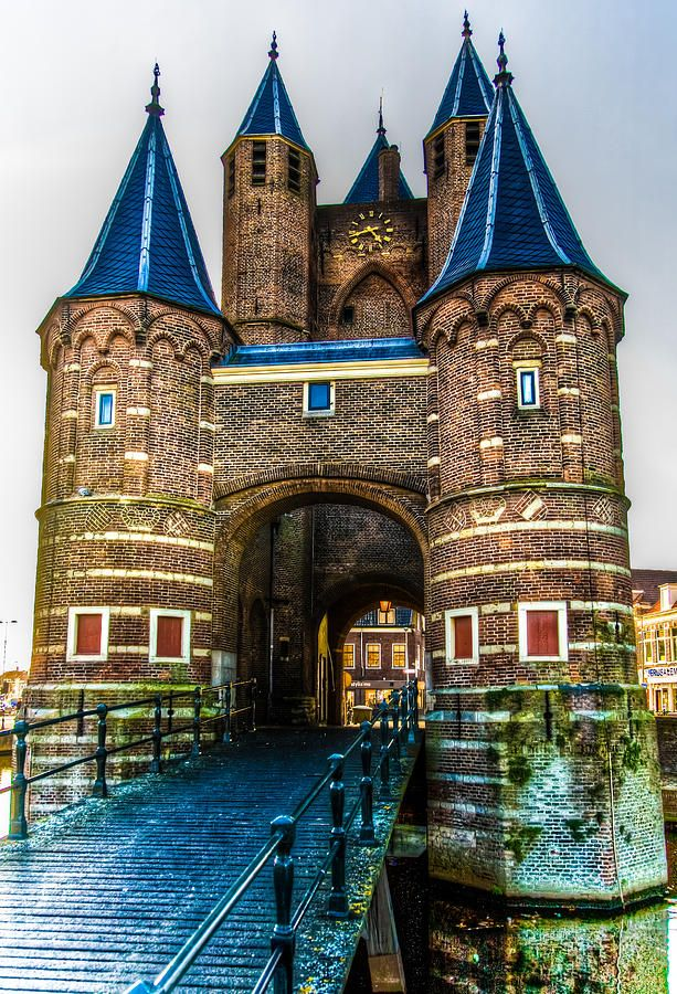 Old City Gates in Harleem, Holland. ** I love the little blue 'hats' on top of the towers.
