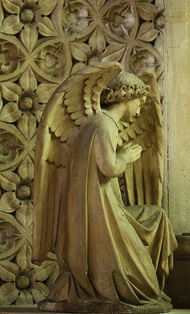 A stone angel in one of the side chapels of St Dominic's, London