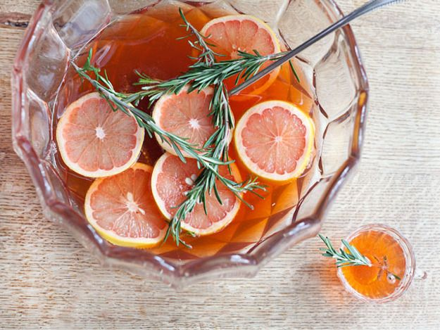 In addition to being gorgeous, this punch has a delicate, fresh flavor: the sweetness from bourbon, honey, and sparkling wine is well-balanced by tart, fresh grapefruit and rosemary-laced Aperol.