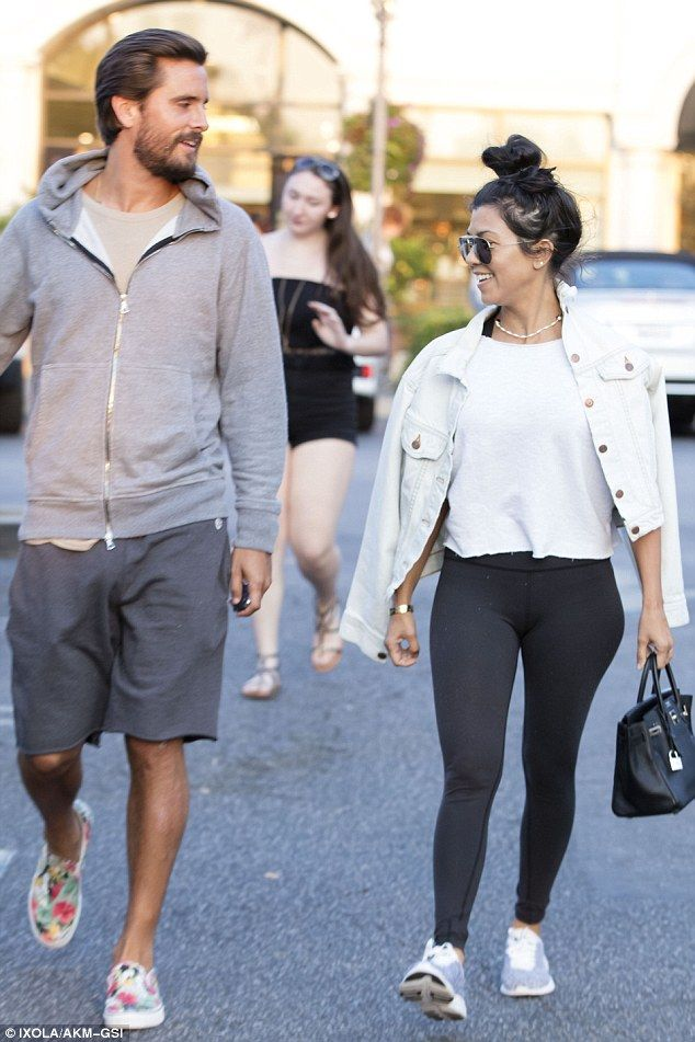 Natural beauty: Kourtney wore her long, raven tresses pulled back into a messy bun, and kept her make-up simple