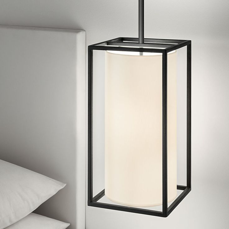 contemporary ceiling lamp design with a round lamp shade embedded in a rectangular iron frame.