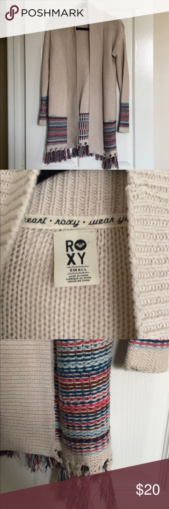 Roxy Cardigan size Small. Great condition! Roxy Cardigan, size Small. Cream with various colors at bottom and sleeves. Great condition. Roxy Sweaters Cardigans