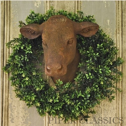 "Yearling Heifer Head, a beautifully crafted cow head from heavy estate stone and detailed to perfection. This vintage inspired reproduction features a distressed, warm brown finish. Add this gorgeous decorative accent to your kitchen or to hang above your fireplace. The texture of the item is perfectly rustic and will add the missing farmhouse touches to any of your rooms. Comes ready to hang. Dimensions: 15"" Wide x 14"" Deep x 15"" High.</p> <p>**ATTENTION ..."