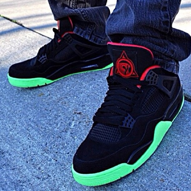 they look like air jordan 4s but with yeezy colors Air
