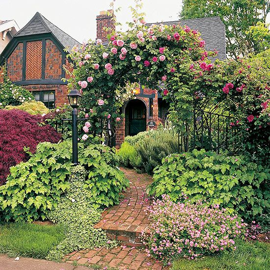 English cottage garden meets English Tudor architecture: pure romanticism.