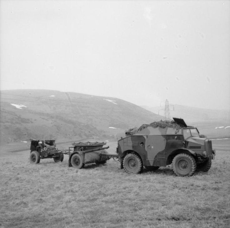 Morris-Commercial C8 'Quad' artillery tractor with limber and 25-pdr field gun, on an exercise in Scotland, 20 March 1941