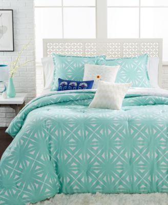 achieve a look with the echo lattice geo aqua comforter mini sets featuring a light aqua green u0026 white pattern that reverses to an alternating