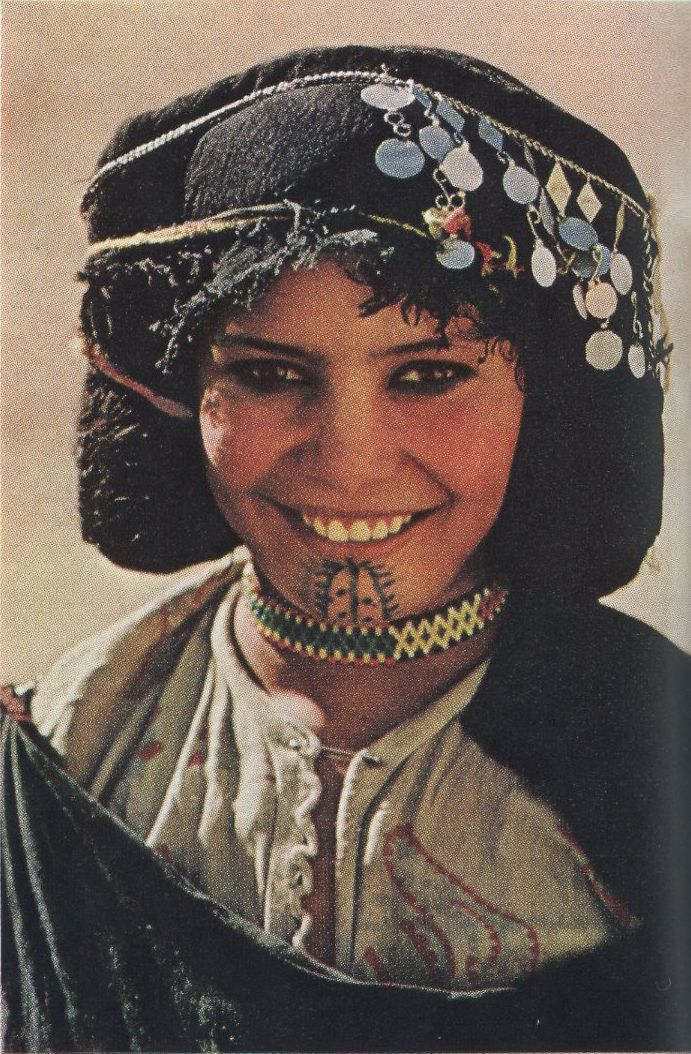 Africa |  Berber girl, Morocco | Image scanned from National Geographic, June 1968, article entitled 'Trek by Mule Among Morocco's Berber'.  Photo and text by Victor Englebert.