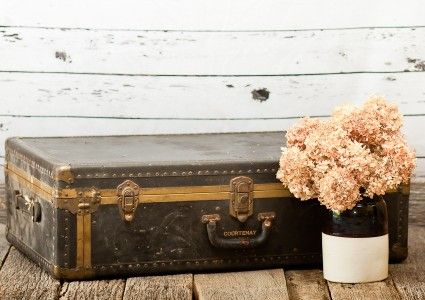 Vintage Wedding and Photography Props Antique Steampunk Ladies Travelers Trunk lined in Brass and a small Crock with Hydrangeas vintagepartyprops.com Louisville Kentucky
