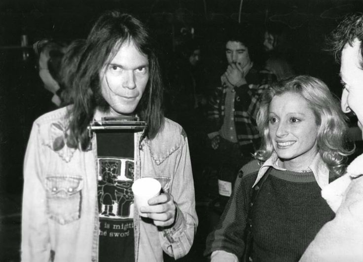 "lestresorscaches: "" Véronique Sanson and Neil Young backstage at a Neil Young concert in Paris in 1976. Photo by Susan Miller. """