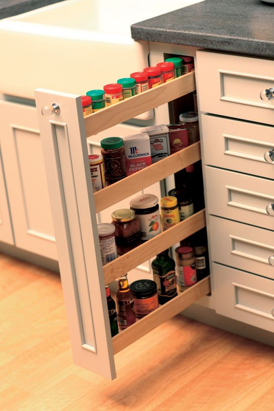 Small spaces offer a surprising amount of spice storage with a vertical Pull-Out Spice Rack