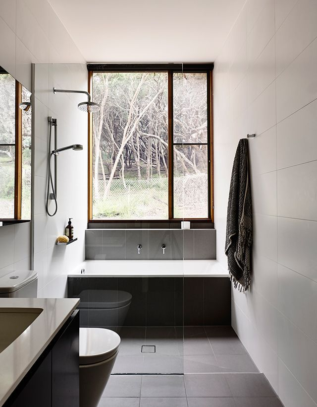 Combined shower/bath space and lovely minimal wall tile. Reminds me of Holland. bathroom inspiration