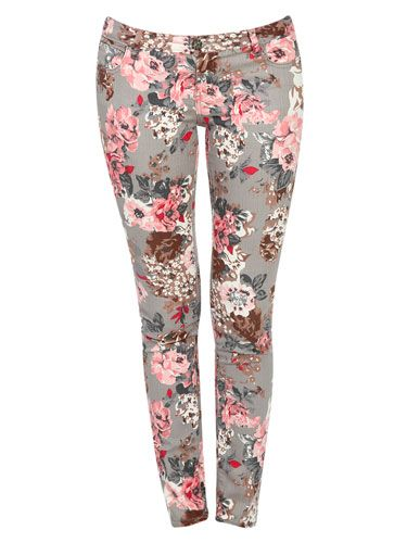 Flower Power - We're loving how the gray base color toughens up these otherwise girly, floral jeans. They're the perfect summer-to-fall transitional item!