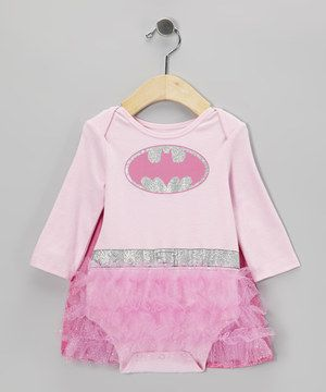 The leap from carpet crawling to sailing over skyscrapers won't seem so impossible once super-human sweeties don this caped bodysuit. Designed with frilly skirt details, a lap neck and snaps along the bottom, it's undeniably girly yet oh-so simple to sport.